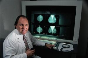doctor-examining-mammograms